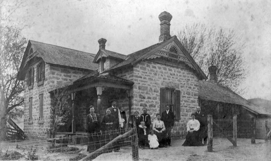 The Pellowskis, ca. 1905. Leokadia is in a black dress with white trim, standing to the right of the porch.
